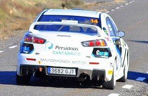 trasera Mitsubishi R4 con Publicidad de Persianas Cantabrico